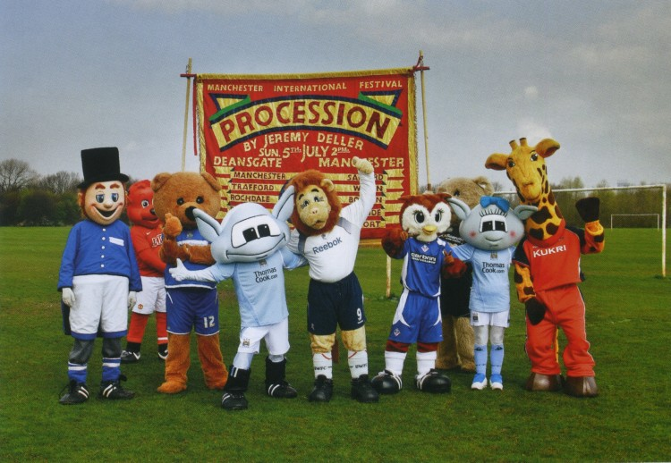 Manchester football mascots holding banner from Procession